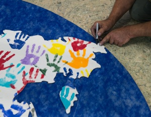 Cutting the hand painted sheets to fit the continents.
